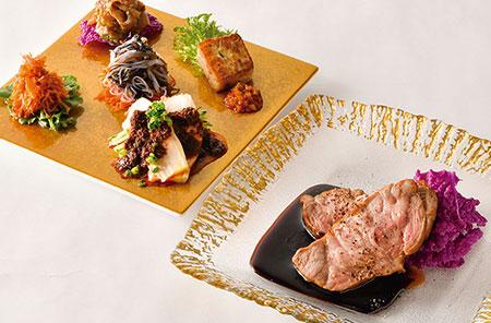 (手前)軽く焼き色を付けた豚の肩ロース肉に黒酢と中国醤油、蜂蜜で味付けした「沖縄産豚肩ロースの黒酢豚」。甘さ控えめで、大人のさっぱりとした味わい。薫り高いカンボジア産の胡椒がアクセント。(奥)人気の「四川風よだれ鶏」を始め、季節によって変わる前菜の盛り合わせ。それぞれが確かなクオリティで、後に続く料理への期待が高まる。